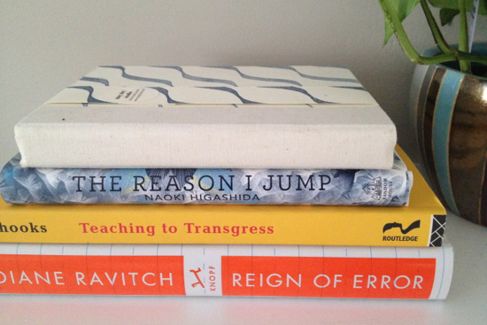 a few books related to education and one blank one